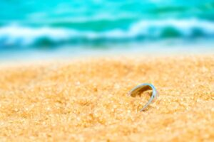 Silver ring on the beach